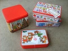 Thrift Store Christmas Tins    Great for wrapping and decorating!    www.the-red-kitchen.com