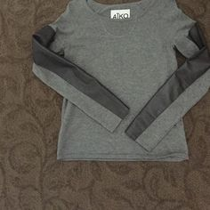 Aiko cotton cashmere sweater w leather  sleeves Excellent condition no pills smoke free pet free home. Purchased last year at Intermix. Aiko Sweaters Crew & Scoop Necks