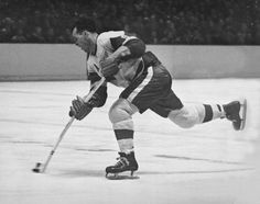 Canadian hockey player Gordie Howe of the Detroit Red Wings fires a shot during a game