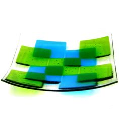 This handmade fused glass bowl from the Fusion range features a geometric design in shades of blue and green. The bowl measures x x and is available in five different colour combinations. including free UK p+p. Fused Glass Plates, Fused Glass Jewelry, Fused Glass Art, Glass Dishes, Mosaic Glass, Glass Bowls, Stained Glass, Slumped Glass, My Glass