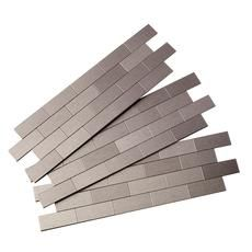 These peel and stick metal tiles make a beautiful kitchen back splash with no glue or grout needed! Sold at Home Depot Canada in packs of 3 covering 1 sq ft.