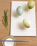 Dyed eggs with grass appliques, from Martha Stewart.