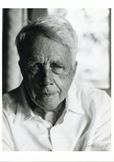 Robert Frost with a half smile