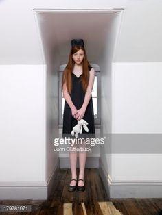 Redhead teen dressed as Alice in Wonderland