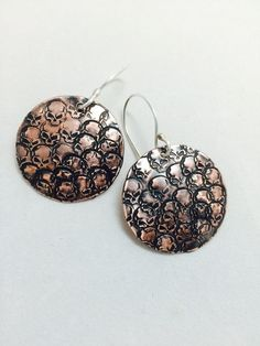 A personal favorite from my Etsy shop https://www.etsy.com/listing/259226284/copper-skully-earrings