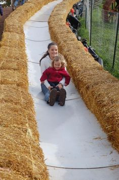 Oh my goodness! A slide made from straw bales, slippery 'boards' and a hill! (more photos and ideas in the post)