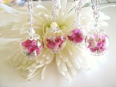 Handmade mini hollow glass bead necklaces with real pink sea lavender and white babys breath dried flowers. ♥ Perfect for bridesmaids!♥ If you