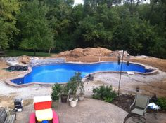 Lagoon shaped vinyl liner swimming pool located in sparks md baltimore county backyard for Swimming pools in baltimore county