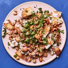 This version of the Levantine breakfast dish, known as fatteh hummus, is all about the contrast of textures and flavors: crunchy pita chips, creamy chickpeas, and tart yogurt.