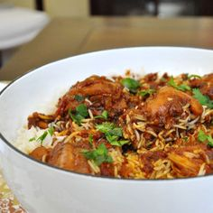 Chicken Biryani Singapore-Style. This is a bit of a fusion dish – Indian and Chinese, which is typical of Singaporean food.  A little more time consuming than most of the dishes we post on this blog but sometimes a little bit of trouble goes a long way.  Works great for a Sunday one-pot family dinner.