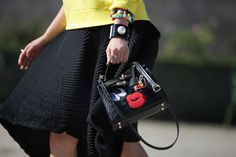 Irene Kim after Issey Miyake SS15. Bag by Fendi, Issey Miyake skirt and Chanel bracelet