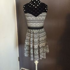 Black and white dress NWT: Mesh collar with sweetheart neckline, elastic waistband. Length is a bit above the knee. Super flattering on a skinny waist. Material Girl Dresses Midi