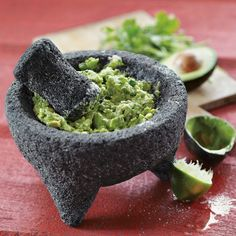 The mortar and pestle carved from volcanic rock is among the world's oldest kitchen tools. Our molcajete (mortar) and tejolete (pestle) are hand carved from a single piece of basalt rock, making each piece unique.        Ideal for crushing whole spices.      Great for serving guacamole.      Line with lettuce leaves to use as a serving bowl.      Hand carved from a single piece of basalt rock.      No two are exactly alike.