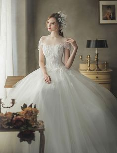 Poofy wedding dress - This offtheshoulder wedding dress from J Sposa featuring beautiful floral appliques is fit for a modern princess! Poofy Wedding Dress, Amazing Wedding Dress, Princess Wedding Dresses, Modest Wedding Dresses, Bridal Dresses, Wedding Gowns, Bridesmaid Dresses, Elven Wedding Dress, Fairy Dress