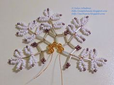 Free detailed tutorial with step by step photos on how to make a snowflake out of beads and bugles. Great for beginners! Pony Bead Patterns, Beaded Jewelry Patterns, Beading Patterns, Wire Crafts, Bead Crafts, Beaded Christmas Ornaments, Christmas Crafts, How To Make Snowflakes, Paper Snowflakes