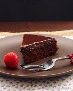 Triple chocolate fudge cake with dark chocolate ganache  - really moist and chocolatey!! delicious warmed up.