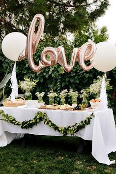 Use balloons to spell out your feelings above the cake table (for both cake and your partner). This rose gold 'love' balloon from Etsy is such an easy way to make a statement look, surrounded by lots of simple foliage. Just imagine the pictures of you cutting the cake with this balloon in the background!