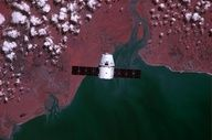 This Dragon spacecraft over Africa taken from the International Space Station with an infrared modified digital camera.