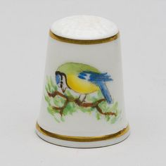 Bone china thimble with hand painted blue tit design, signed C Moody. Height: Width: This item is for sale at the Museum of Royal Worcester's online shop. Candle Snuffer, Blue Tit, Museum Shop, Thimble, Worcester, New Words, Bone China, Porcelain, Hand Painted