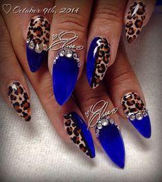 Blue, leopard print & rhinestone nail art.
