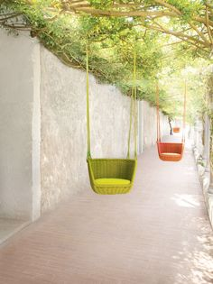 Paola Lenti's handwoven Adagio chairs are a cheery, grown-up version of the classic children's swing; from $2,555 | archdigest.com