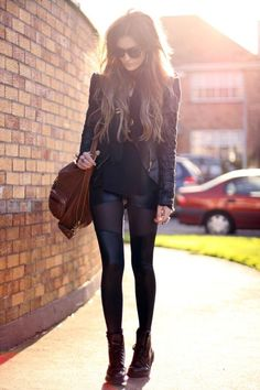 Hot. Just hot. Love the black on black, leggings, leather jacket, booties and teased hair. Very rock and roll. ;)