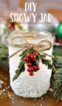 How beautiful is this snowy mason jar decoration?! This is a lovely Christmas DIY centrepiece. A great winter craft to make this Christmas!