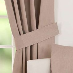 Completed in a biscuit brown colourway, these plain curtain tiebacks feature…