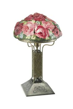 PAIRPOINT A 'Red and White Rose Bouquet' Reverse-Painted Glass and Silvered-Metal Table Lamp, circa 1905 with clear glass prisms 21 in. (53.3 cm.) high, 13 in. (33 cm.) diameter of shade base stamped PAIRPOINT MFG. CO 3054 with factory monogram
