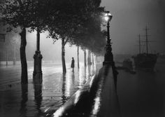 Rainy Embankment, A man standing alone on a rain-drenched pavement on the River Thames Embankment, London, 1929