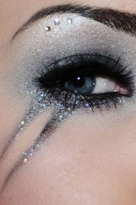 silver and glitter. plus it drops down her face.. kirsten would LOVE. -sydni
