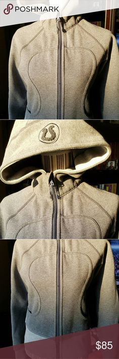 Lululemon Gray Hoodie Zip Sweatshirt I think this is called a Scuba Hoody, but this EUC, inside and out, doesn't have the  thumb holes. The fabric is that thick, plush, warm fabric of high end sweatshirts. The back tag isn't on, but the inside pocket ID tag indicates Size 6 and the ID tag was never used. All proceeds go to XS Tennis Education Foundation in Chicago. This sweatshirt is awesome!!! lululemon athletica Tops Sweatshirts & Hoodies