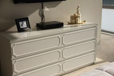 Ikea MALM hack with overlays. Great way to make that modern dresser of my hubby's match the rest of the room!