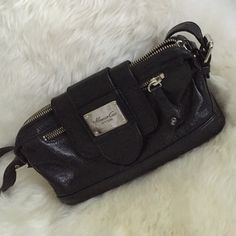 Kenneth Cole New York handbag A beautiful classic Kenneth Cole New York black leather handbag! A great go to for going out. Great condition! Adjustable shoulder strap. Kenneth Cole Bags Shoulder Bags