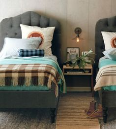 Sam's room when he's older?  I wouldn't use those headboards, but I do like the turquoise/grey/brown combo.