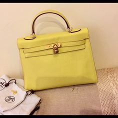 Hermes Kelly 32 cm Iconic Hermes Kelly in lime green. Excellent condition. Pebbled leather. Was bought off eBay for 1200$. Comes with the dust bag, key and shoulder strap. Good tone hardware. Price denotes authenticity, please don't ask. Hermes Bags Totes