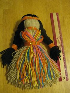 Simple Yarn Doll made by making  like a tassel. A pilgrim can be made without the long hair and adding an apron and hat.