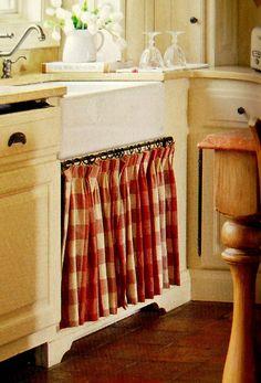 I adore this curtain under the sink!  Country French Magazine | Fall/Winter2011 | Homeowner/Designer Corine de Libran Longanbach | Photographer Richard Leo Johnson