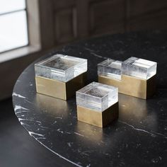 KELLY WEARSTLER | ARIA COLLECTION. Handcrafted from cast recycled vintage crystal glass and solid architectural brass.