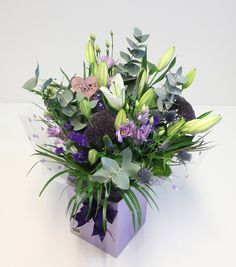 This striking luxurious hand-tied bouquet combines white lilies, lissi lilac, fresh eucalyptus, palm leaves and vibrant blue thistle. An elegant arrangement, with an attractive heart pick, this bouquet comes carefully wrapped in an aqua pack, ready for display in an attractive gift box. The perfect treat for a mum who loves a splash of purple. £35.