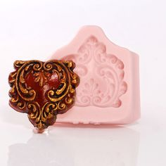 Scroll Work Heart Silicone Mold Flexible Cabochon Mold Food Safe use with Fondant Chocolate Candy Mints Butter or Craft Mold Resin Clay (753 by MoldMeShapeMe on Etsy https://www.etsy.com/listing/387599156/scroll-work-heart-silicone-mold-flexible