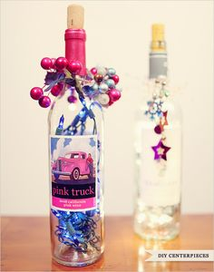 Upcycling Inspiration Pack-Insanely Gorgeous DIY Wine Bottle Centerpieces That You Must Try Pink Wedding Centerpieces, Wine Bottle Centerpieces, Lighted Wine Bottles, Wedding Table Centerpieces, Centerpiece Decorations, Bottle Lights, Bottle Decorations, Centerpiece Flowers, Empty Bottles
