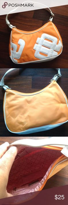Purse Cute orange and white JLo purse great condition no fares rips or stains used maybe twice! Jennifer Lopez Bags Hobos