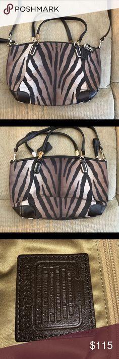 "Coach Madison Zebra Print Kelsey Handbag Coach Madison Zebra Print Kelsey Handbag -  H1393-28093 * Detachable Leather Shoulder/Cross Body Strap * Zip Top Closure * Gold Tone Hardware * Leather Zipper Pulls * 2 Coach Hangtags Gold Metal Hangtag/Dark Brown Leather Hangtag * Gorgeous Deep Gold Sateen Lining * Leather Coach Creed Patch * Beautiful Zebra Print in Browns/Tans/Beiges  *Measurements  14""(L) x 8 3/4""(H) x 2 1/2""(W)  5 1/2"" Double Handle Drop  22"" Detachable Leather Crossbody Strap…"