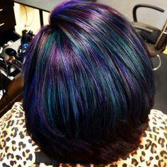 Iridescent duck feather/ oil slick hair.
