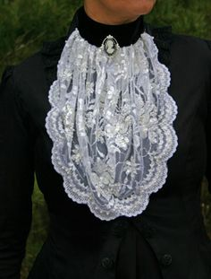 White Beaded Lace Jabot - Price: $55.95  Shimmering white venice lace jabot generously beaded with sequins and pearls. The lace is gathered to a black velvet collar, which buttons in the back.
