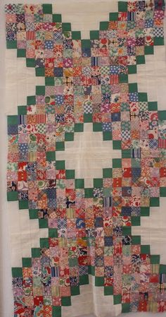 This quilt piece contains 561 squares from 134 different feedsacks!