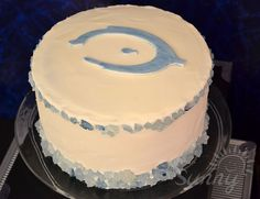 Halo cake for a Halo Video Game Birthday Party... such a simple cake but the best for this party.The blue rock candy is great. For a birthday party this one was just right. The birthday boy and his guests loved it.