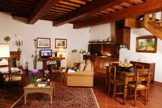 """Very nice apartment named il Granaio on 2 floors. In the ground floor a large living room with fireplace.  there is a large arched door that takes you from the private terrace to a very spacious living/dining room with fireplace, LCD 26"""" satellite TV, well equipped cooking corner where you can cook this typical special Italian Dishes in front of a good glass of red wine  L'appartamento granaio suddiviso in due piani è una chicca nel cuore della toscana dotato di ogni confort"""