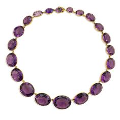 An antique graduated amethyst rivière necklace, in 15k gold. England. Center largest amethyst measures approx. 20 x 24mm, including mount.  Circa 1870